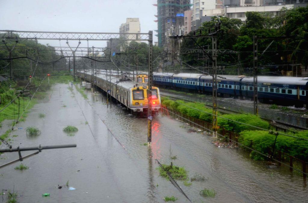 A view of the flooded railway tracks at Matunga railway station as heavy rains lash Mumbai, on July 10, 2018.