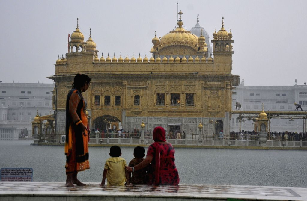 A view of the Golden temple during rains in Amritsar on June 27, 2017.