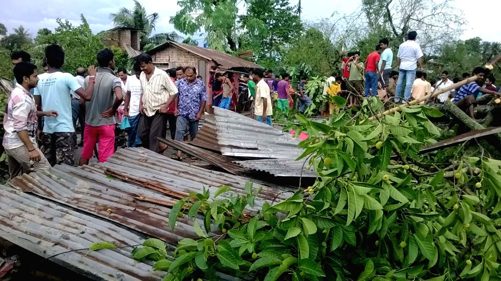 A view of the houses destroyed in cyclone in Habra of West Bengal's North 24 Parganas on July 29, 2015.