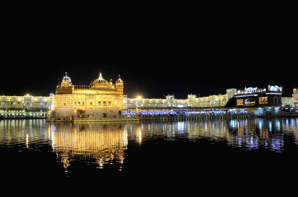 A view of the Illuminated Golden Temple on the eve of Diwali, in Amritsar on Nov 13, 2020.