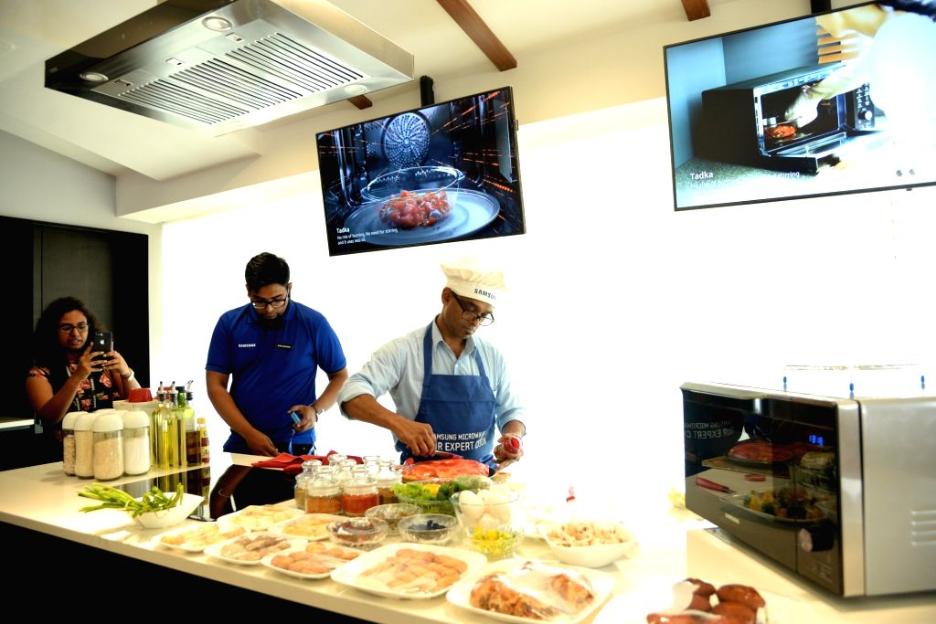 A view of the kitchen set-up at Samsung's newly inaugurated largest mobile experience centre, where a chef would give live cooking demonstrations using Samsung smart ovens, in Bengaluru on ...