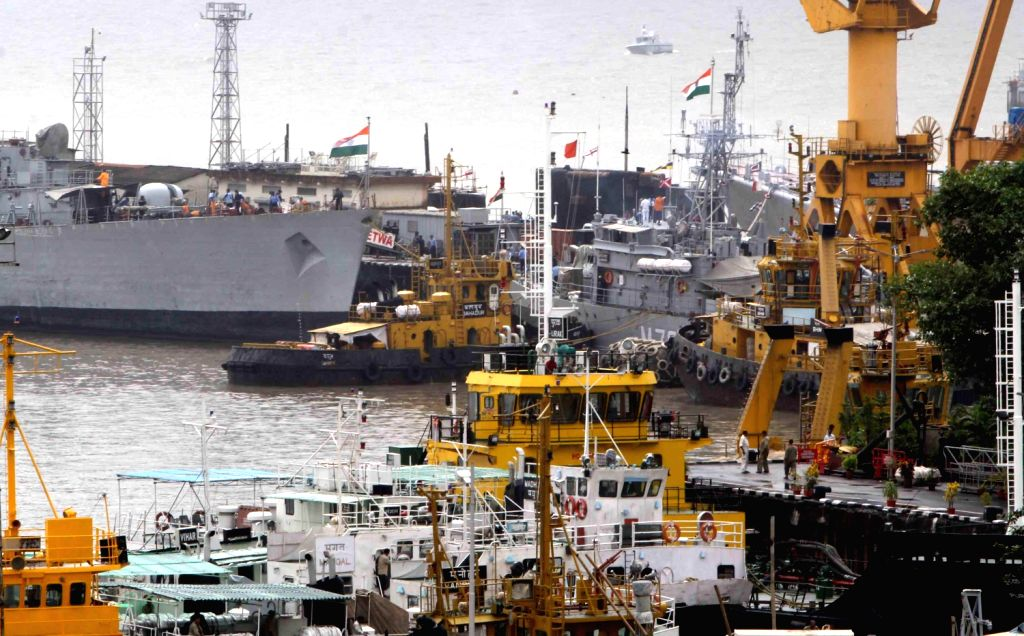 A view of the naval dockyard where INS Sindhurakshak submarine sank due to explosion on August 13 night in Mumbai. (Photo::: BL Soni/ IANS)