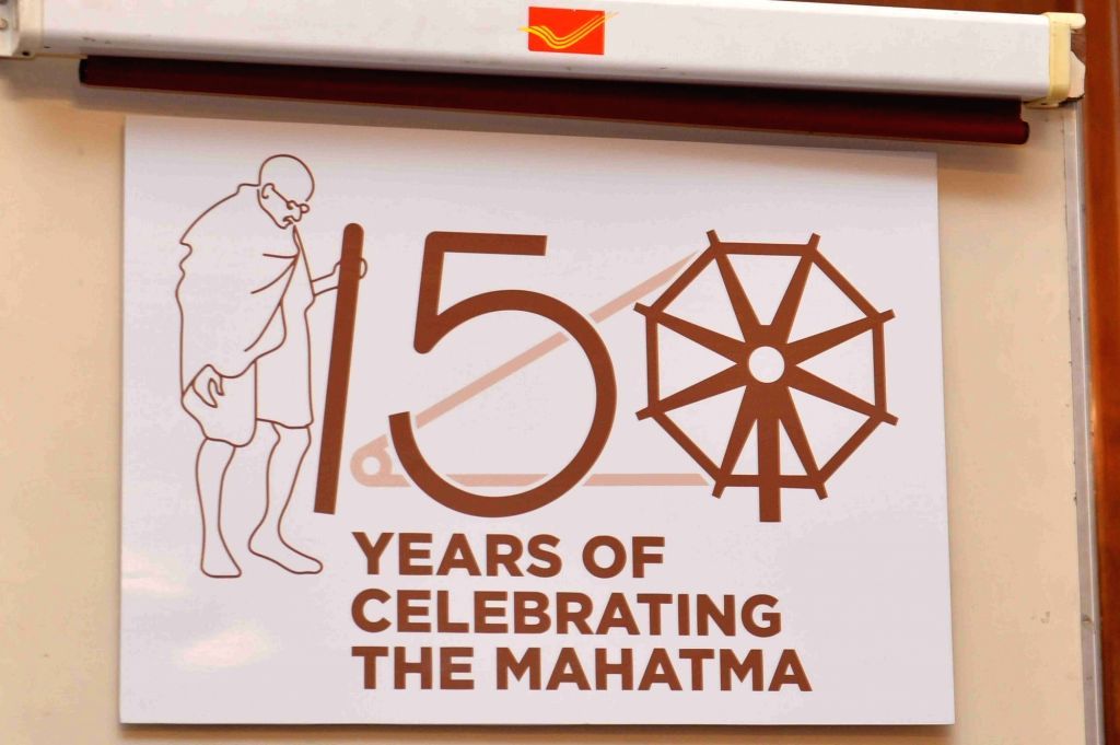 A view of the new logo launched by President Ram Nath Kovind and Union MoS Culture and Tourism and Civil Aviation Mahesh Sharma to commemorate the 150th birth anniversary of Mahatma ... - Nath Kovind and Aviation Mahesh Sharma