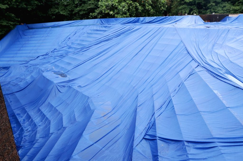 A view of the open auditorium at the Kala Academy covered with tarpaulin sheet to protect the space from leakage and damage during monsoon, in Panaji on July 25, 2019. Kala Academy will be ...