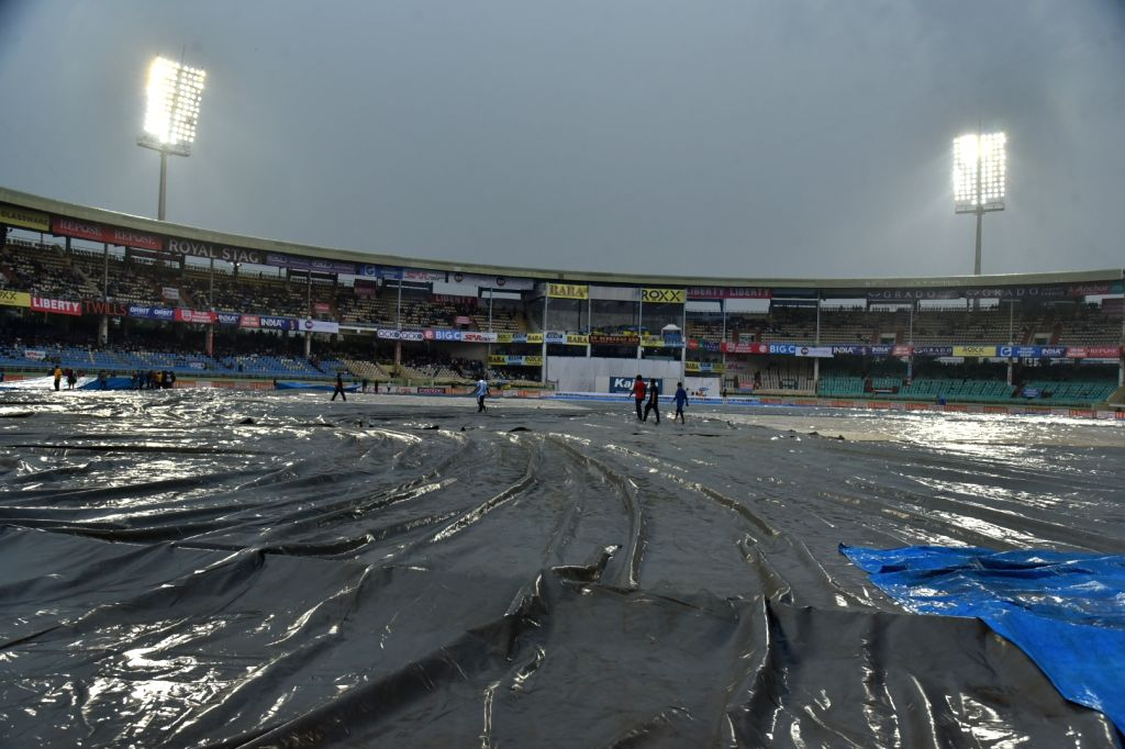 A view of the pitch at Dr. Y.S. Rajasekhara Reddy ACA-VDCA Cricket Stadium covered with plastic sheets during rains on Day 1 of the 1st Test match between India and South Africa in ...