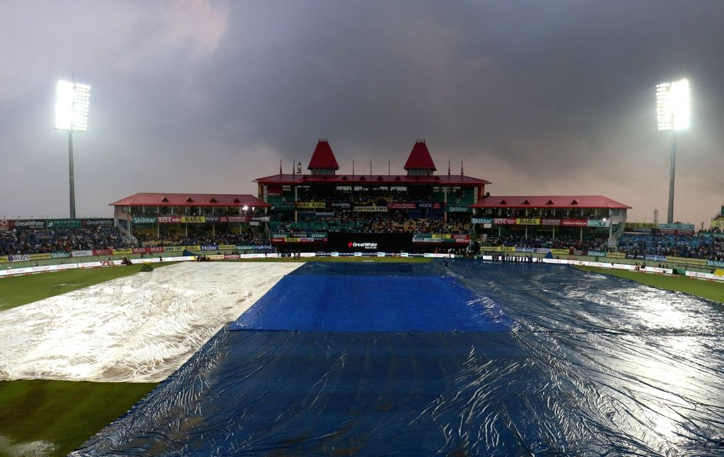 A view of the pitch at Himachal Pradesh Cricket Association Stadium covered with plastic sheets during rains ahead of the first T20I match between India and South Africa in Dharamsala on ...
