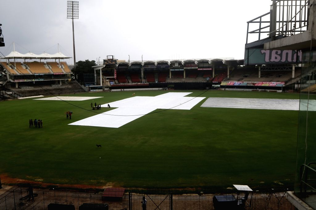 A view of the pitch covered with plastic sheets during rains ahead of the 1st one-day international (ODI) match between India and West Indies, at the MA Chidambaram stadium in Chennai on Dec ...