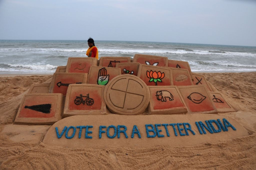 "A view of the sand art for voter awareness with the message ""Vote for a better India"" made by sand artist Manas Kumar Sahoo, at Puri beach in Odisha, on April 9, 2019. - Manas Kumar Sahoo"