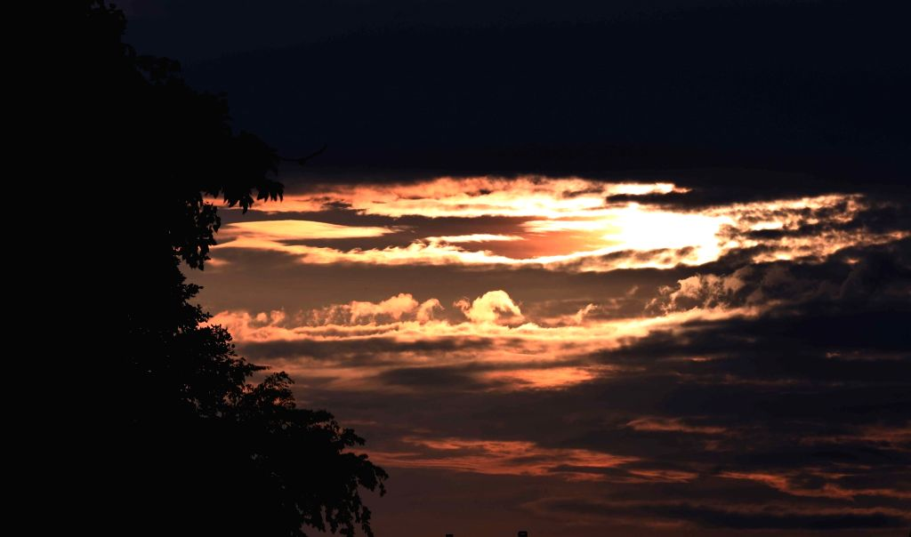 A view of the setting sun amid clouds in Patna on Aug 25, 2019.