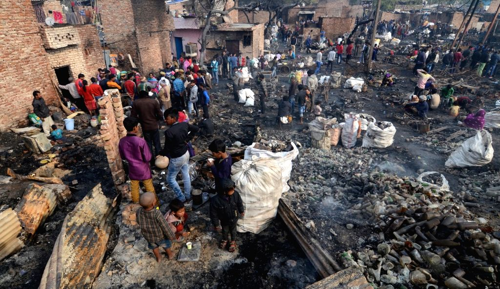 A view of the site at Shaheed Bhagat Singh Camp where a fire gutted at least 250 shanties, in Paschim Puri of west Delhi on Feb 13, 2019. The Delhi government has announced Rs 25,000 for ... - Bhagat Singh Camp
