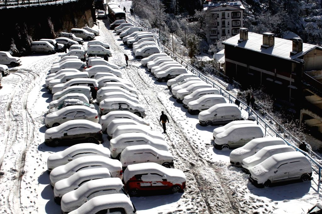 A view of the snow-covered cars after snowfall in Shimla, on Feb 8, 2019.