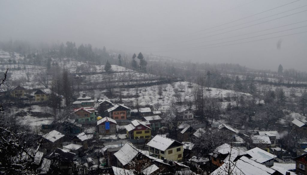 A view of the snow-covered houses and landscape after fresh snowfall in Jammu and kashmir's Baramulla District on Feb 12, 2018.