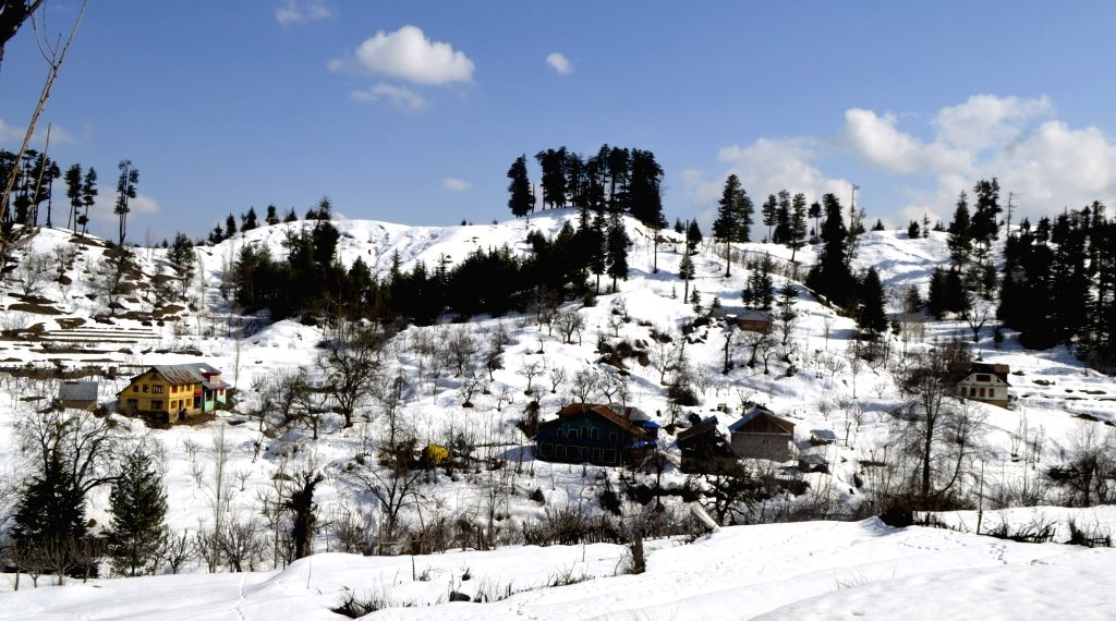 A view of the snow-covered landscape of Jammu and Kashmir's Baramulla after snowfall, on March 12, 2019.
