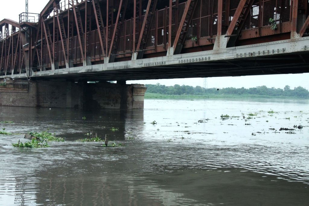 A view of the swollen Yamuna river following incessant rains, in New Delhi, on July 27, 2018. The water level in the Yamuna in Delhi has reached 203.84 metres and is expected to touch the ...