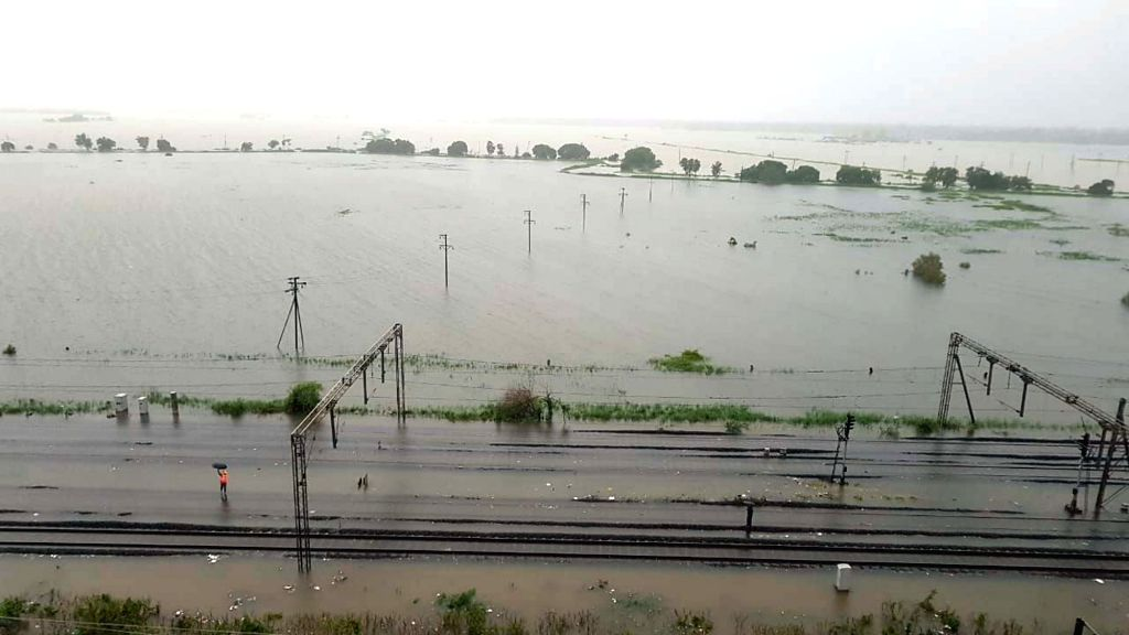 A view of the water-logged tracks at Vasai Road railway station in Maharashtra's Vasai on July 10, 2018.