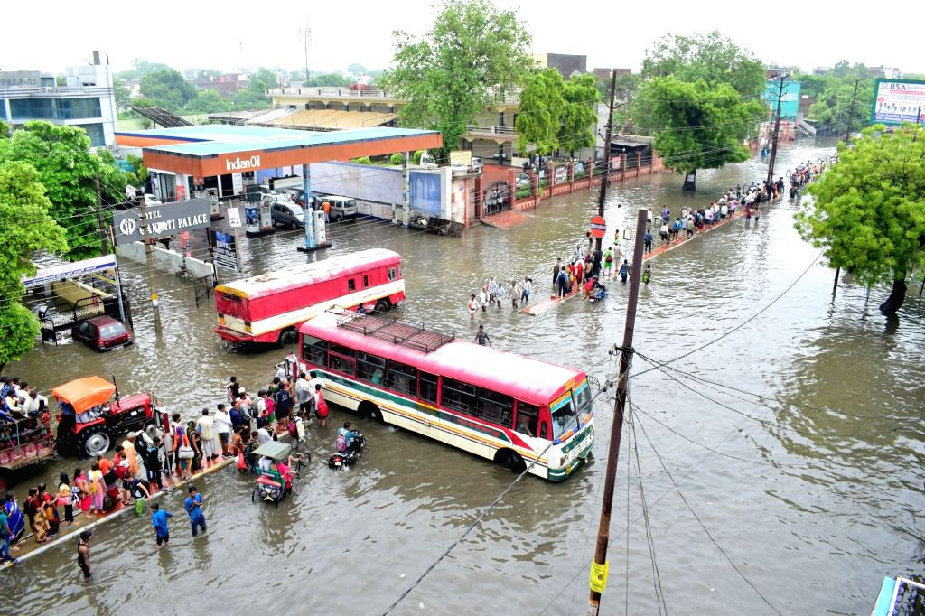 A view of the waterlogged streets after heavy rains lashed Mathura, on July 26, 2018.