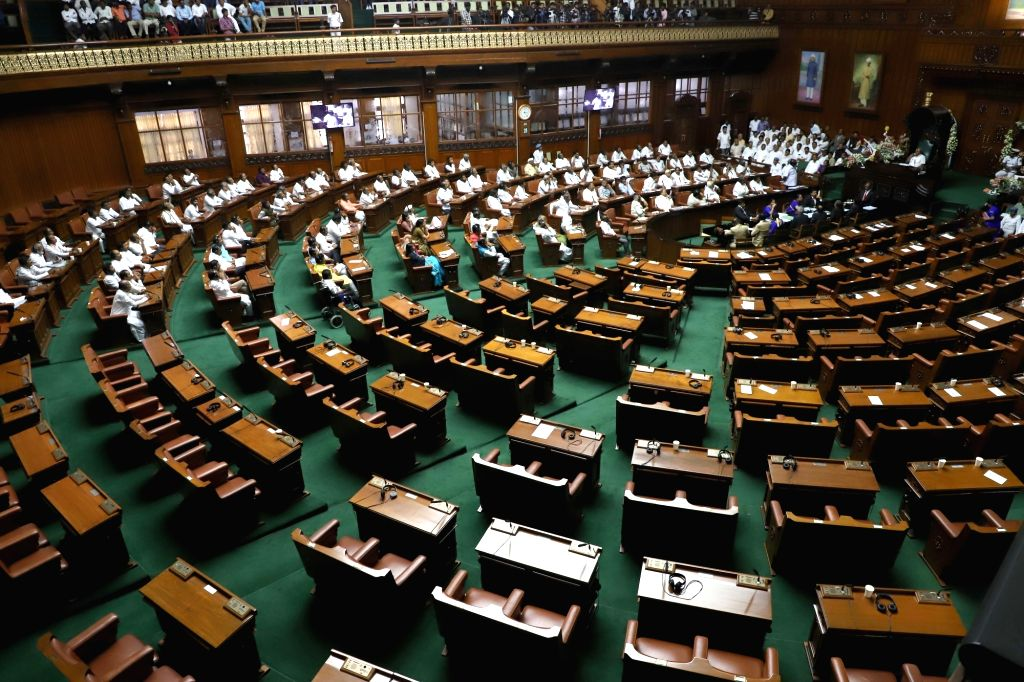 A view of vacant seats after Karnataka BJP legislators walked out of the Karnataka Assembly ahead of the trust vote moved by Chief Minister H.D. Kumaraswamy in the House in Bengaluru on ... - H.