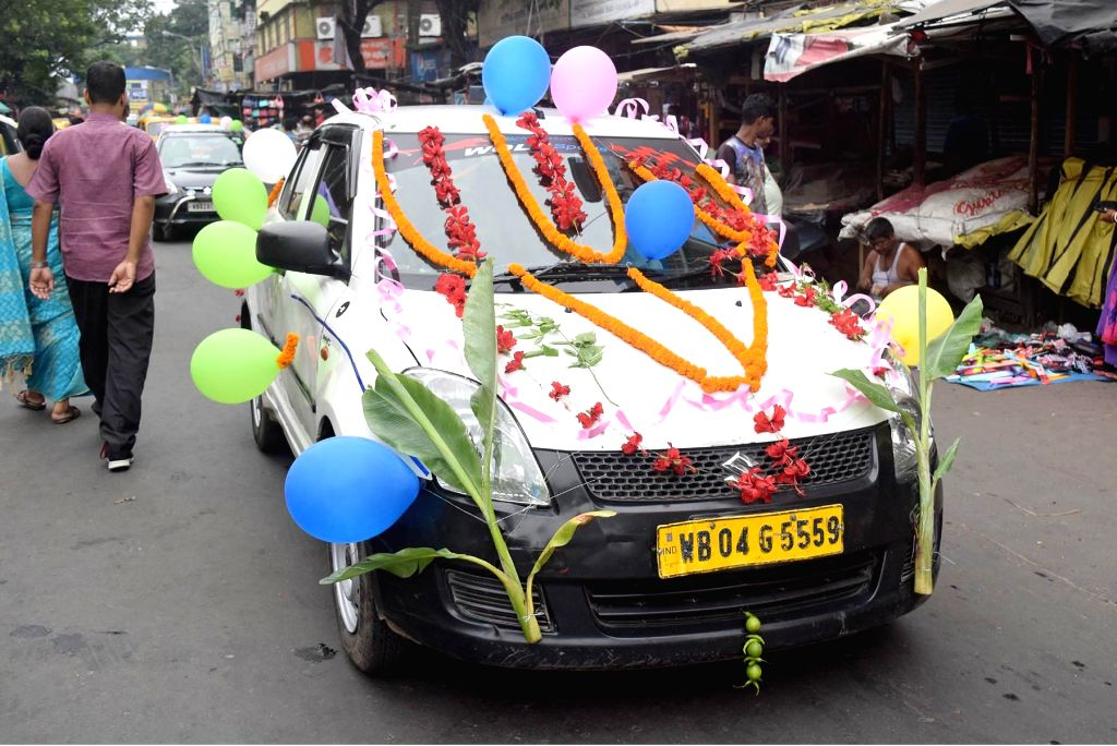 A view of vehicles decorated on the occasion of Vishakarma Puja in Kolkata on Sep 17, 2017.