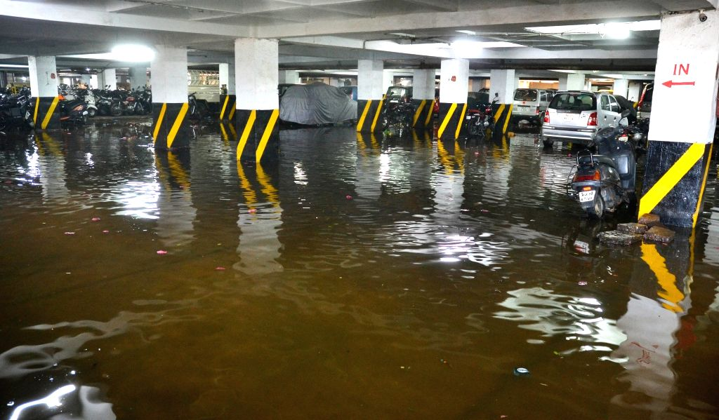 A view of water logged K R Market parking lot in Bengaluru on May 27, 2017. Heavy rains lashed the city on 26th May