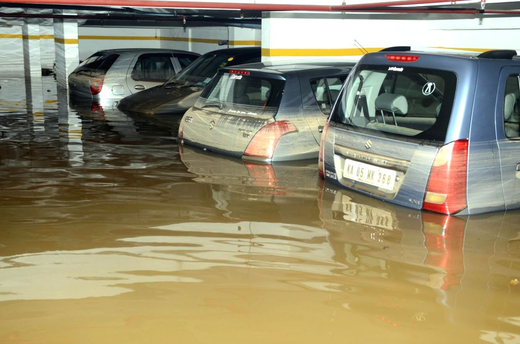A view of water logged parking lot after rains in Bengaluru on May 20, 2016.