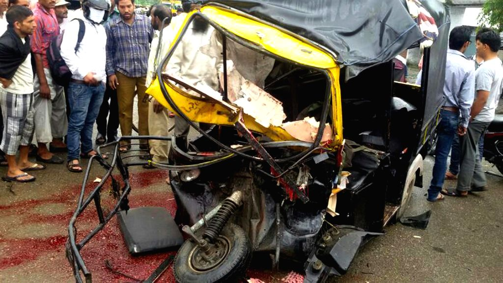 A View of Wreckage of Auto Rickhaw which after it collided with the bus. Following the accident the driver of the auto was killed and nine school children were injured in Punjab on July 24, 2014.