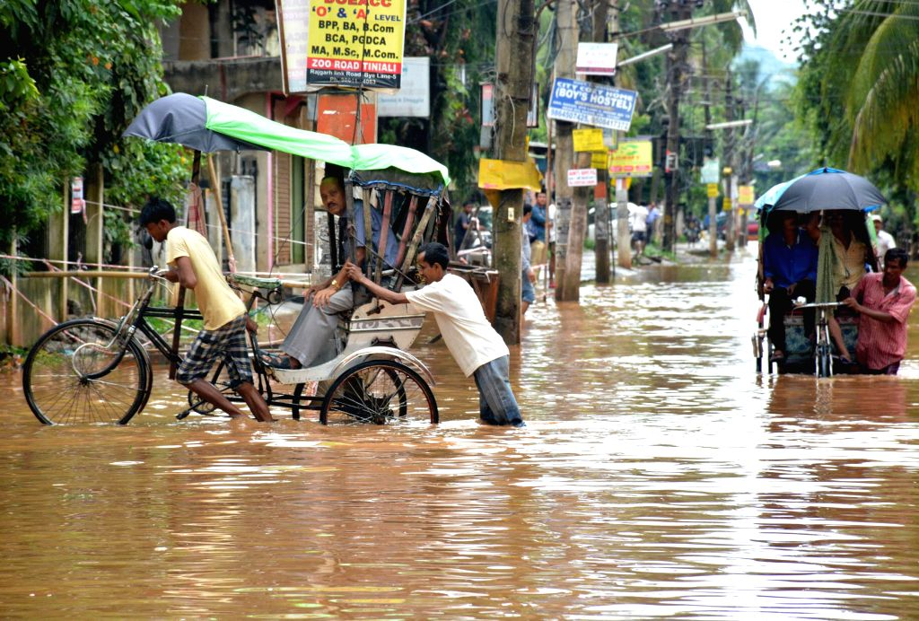 A view waterlogged streets of Guwahati after heavy rain falls on Aug 14, 2014.
