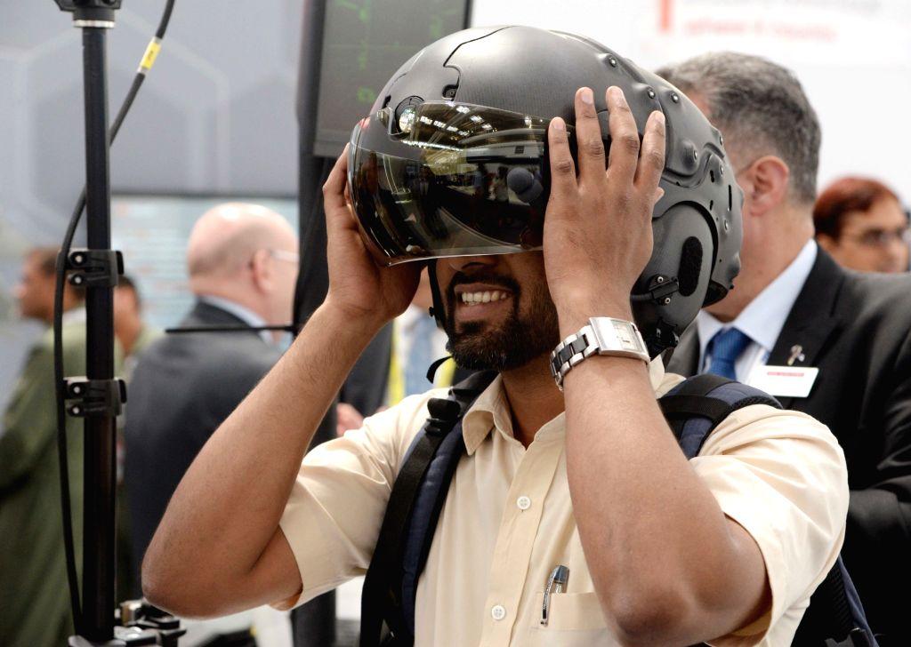 """A visitor at """"Aero India 2019"""" at Yelahanka Air Force Station, in Bengaluru, on Feb 21, 2019."""
