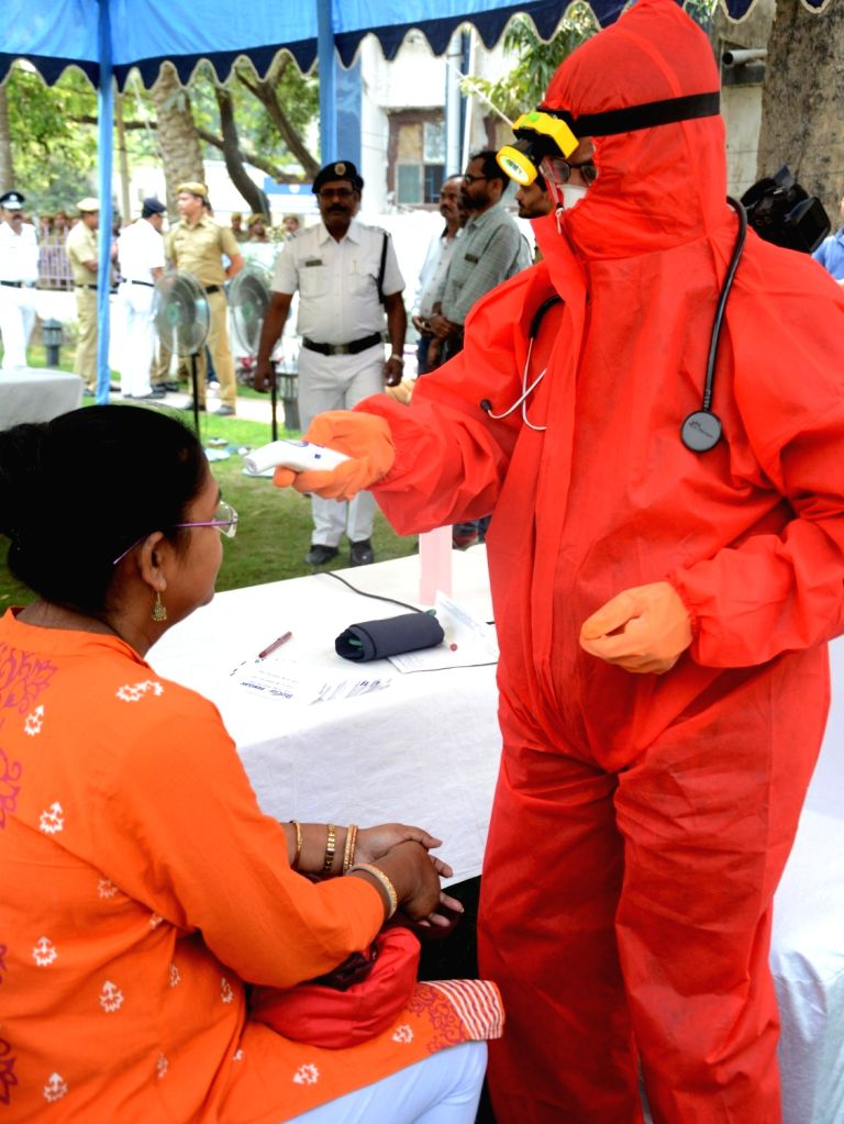 A visitor being screened for COVID-19 (coronavirus) at the Bodyguard Police Line Ground in Kolkata, on March 18, 2020.