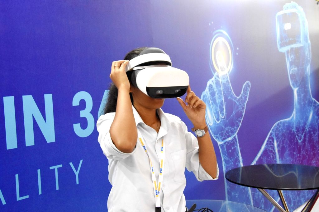 A visitor wearing a VR headset at the inauguration of TTF (Travel Trade Fair) at Palace Grounds, in Bengaluru on Feb 15, 2019.