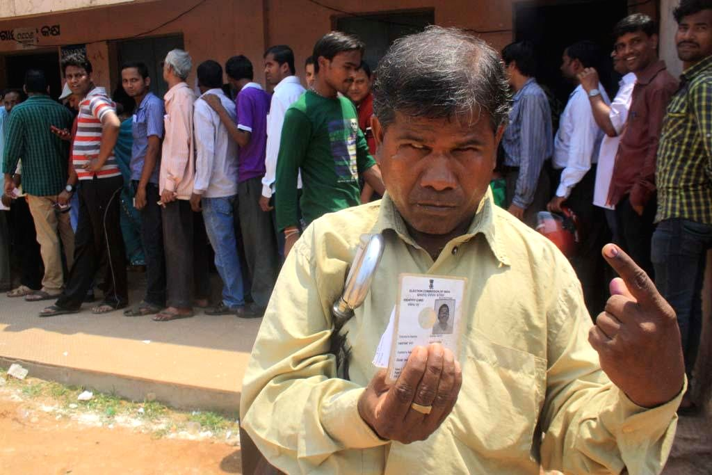 A visually challenged person shows his voters' identity card after casting his vote at a polling booth during the fifth phase of  2014 Lok Sabha Polls in Bhubaneswar on April 17, 2014. (Photo : ...