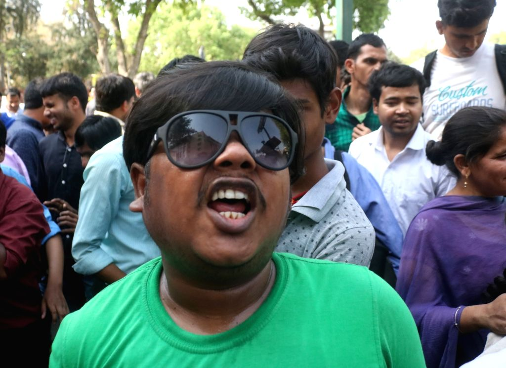 A visually challenged person stages a demonstration to press for his various demands, at Rail Bhavan in New Delhi, on April 12, 2019.