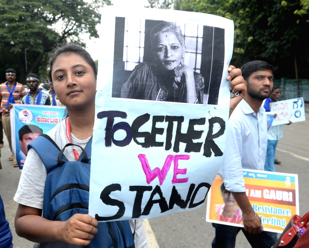 A volunteer during a protest rally against the killing of journalist turned activist Gauri Lankesh at Central College Ground in Bengaluru on Sept 12, 2017.