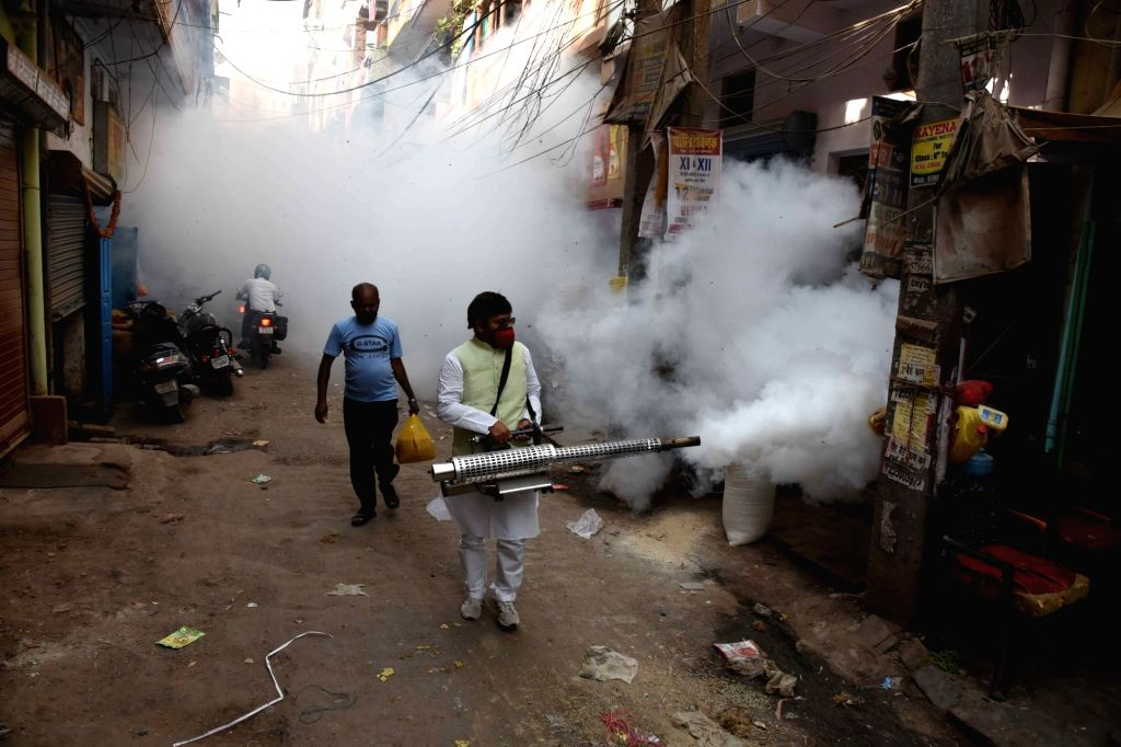 A volunteer fumigated the local area as a precautionary measures against dengue and malaria, in Patna on Thursday April 15,2021.