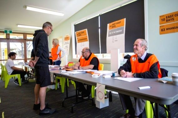 A voter casts ballot at a voting place in Auckland, New Zealand, Oct. 17, 2020.