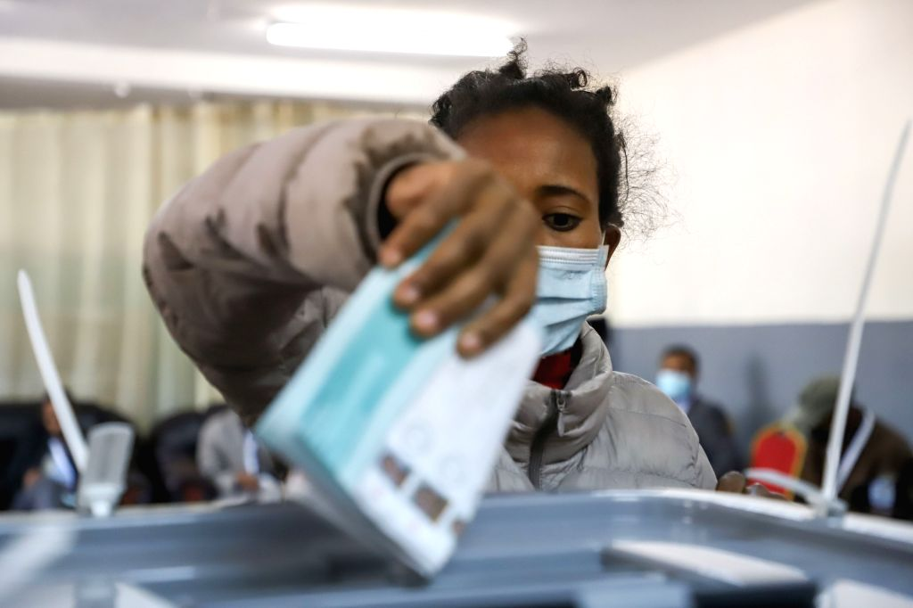 A voter is casting her vote at a polling station in Addis Ababa, Ethiopia, on June 21, 2021.