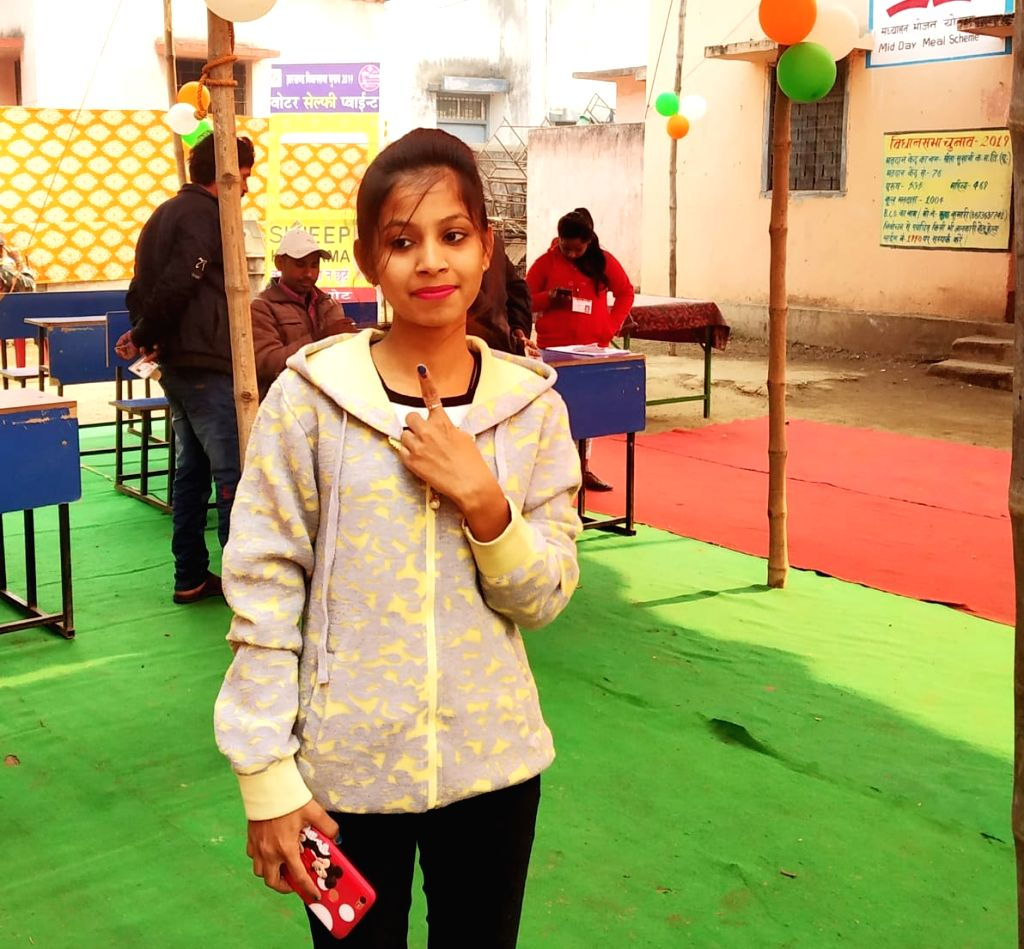 A voter shows her inked finger after casting her vote at a polling station during the third phase of Jharkhand Assembly elections, in Koderma on Dec 12, 2019.