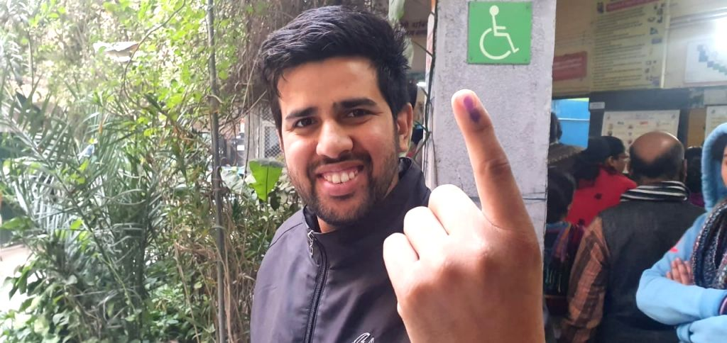 A voter shows his inked finger after casting his vote for the Delhi Assembly elections 2020, on Feb 8, 2020.