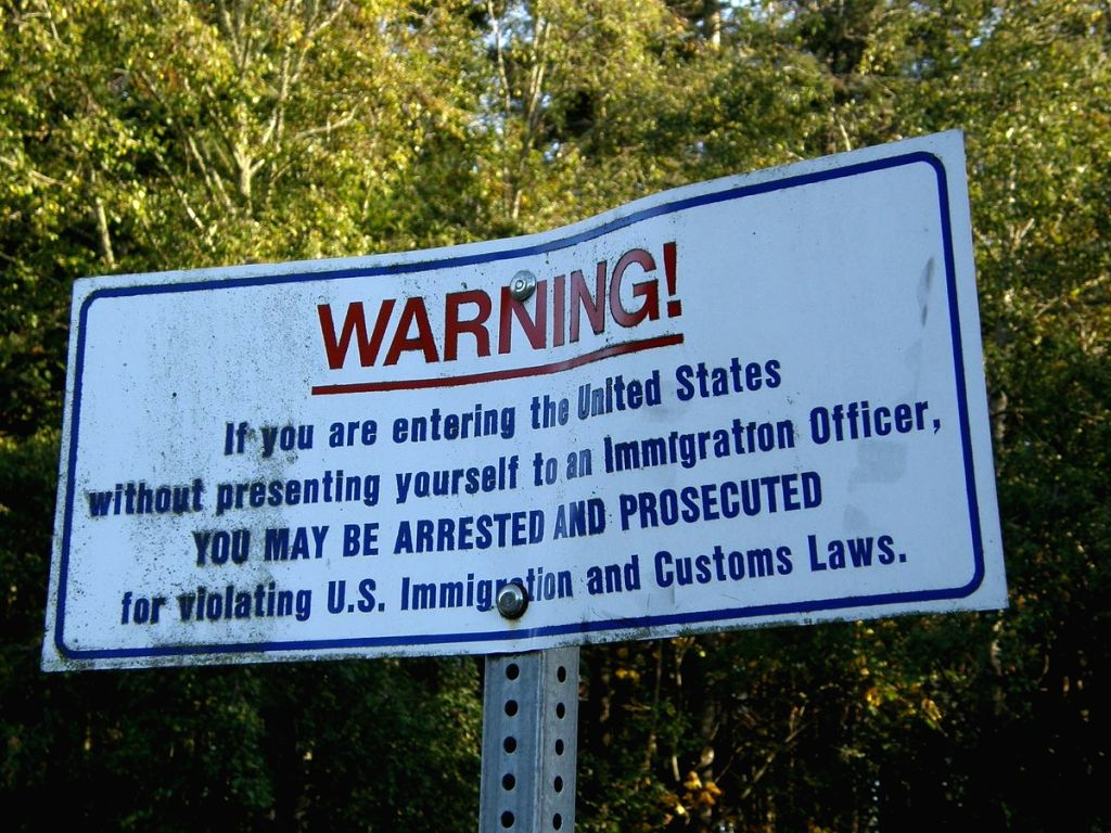 A warning notice at a border point between Canada and the United States.