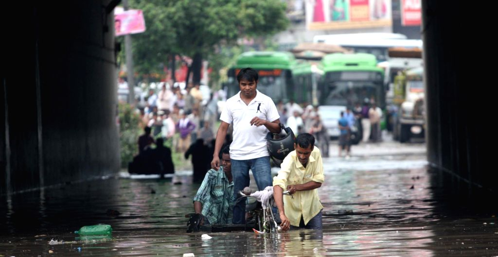 A water logged underpass at Badarpur in New Delhi after the rain on August 16, 2013. (Photo::: IANS)
