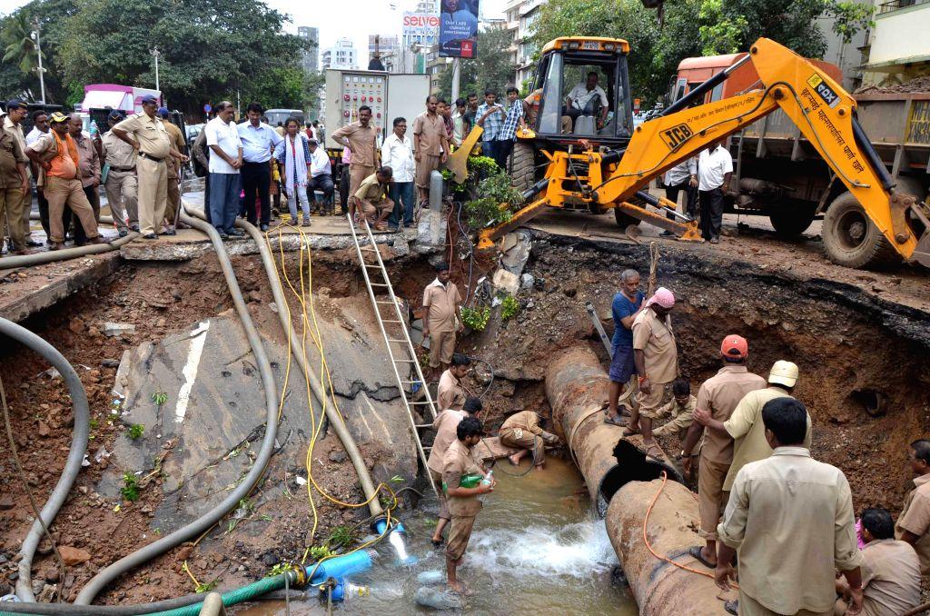 A water pipeline burst near Chowpatty in Mumbai on August 24, 2013. (Photo::: BL Soni/IANS)
