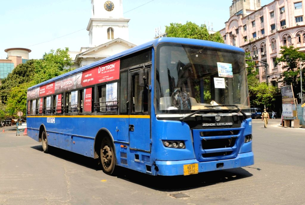 A West Bengal Transport Corporation (WBTC) bus plies as part of emergency services on Day 6 of the 21-day countrywide lockdown imposed to contain the spread of novel coronavirus, in Kolkata ...