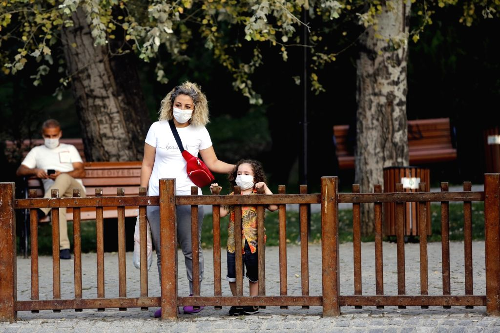 A woman and a child wearing masks visit a park in Ankara, Turkey, on Sept. 11, 2020. Turkey confirmed 1,671 new COVID-19 cases on Friday, raising the total ...