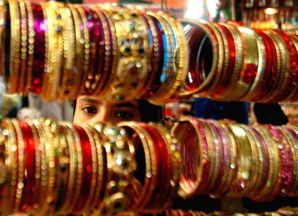 A woman at a bangle shop ahead of Eid-ul-Fitr in Kolkata on July 23, 2014.