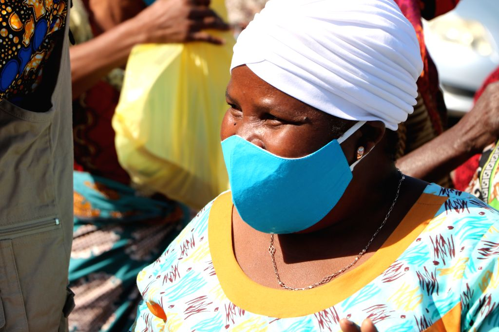 A woman attends a face mask distribution ceremony in Maputo, Mozambique, on July 31, 2020. The government of Maputo distributed some 13,000 face masks to 4,500 ...