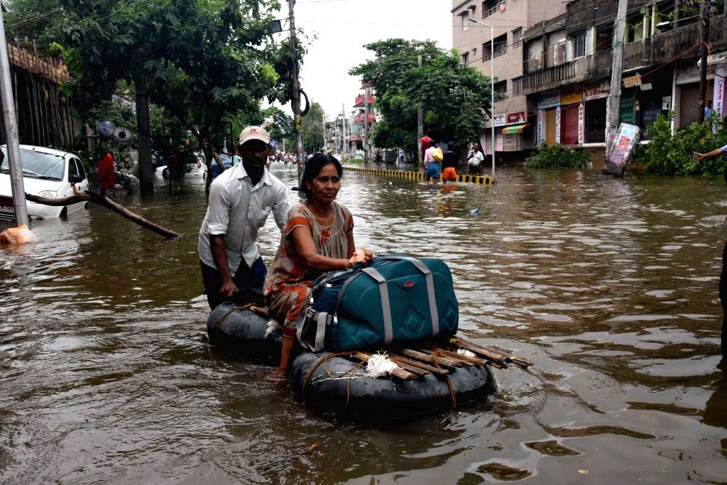 A woman being evacuated on a raft in the flood affected Patna, on Sep 30, 2019.
