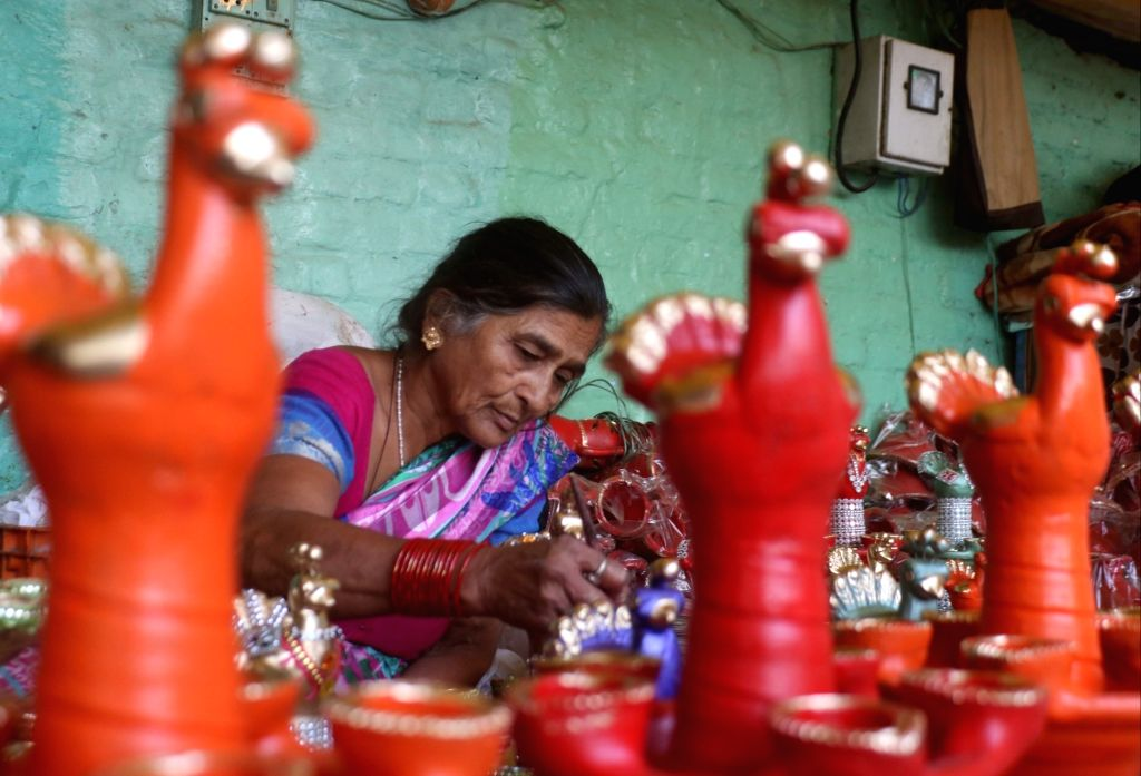 A woman busy at a workshop ahead of Diwali celebrations, in New Delhi on Oct 18, 2019.