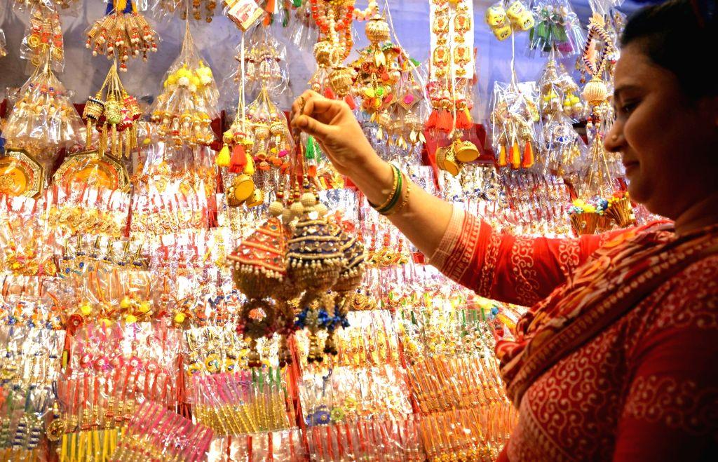 A woman busy buying rakhis ahead of Raksha Bandhan in Kolkata on Aug 11, 2019.