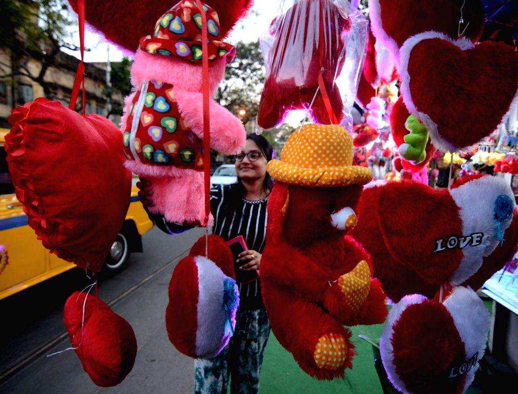A woman busy purchasing gifts ahead of Valentine's Day, in Patna on Feb 12, 2020.
