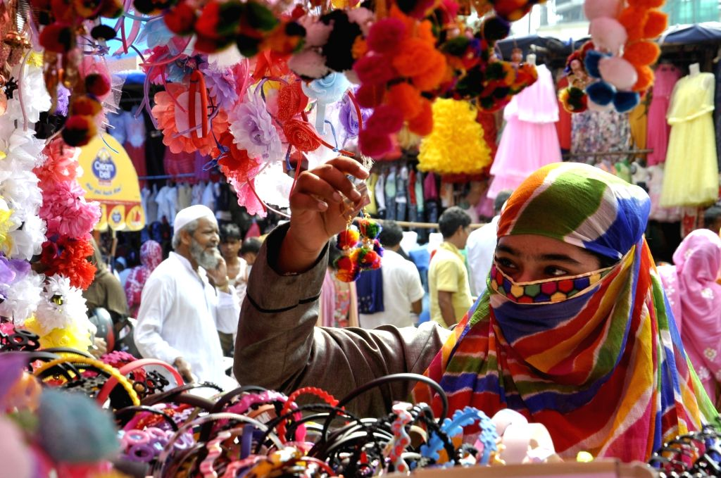 A woman busy with Eid shopping in Kolkata on June 22, 2017.