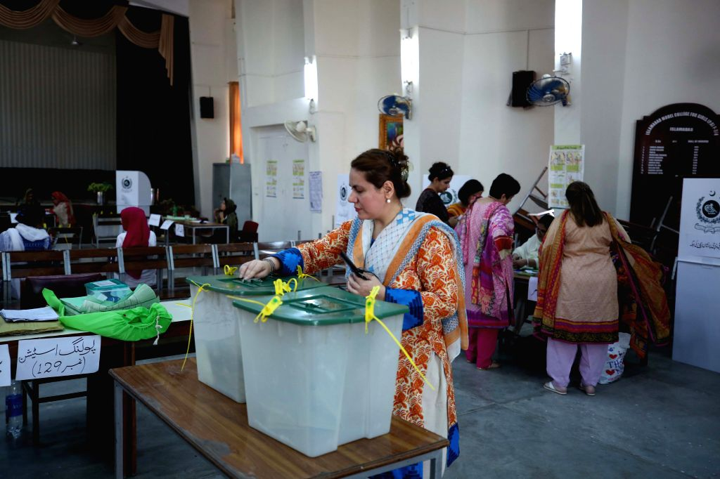 : A woman casts her vote at a polling station in Islamabad, capital of Pakistan, on July 25, 2018. Pakistanis started casting votes in the country's one-day ...